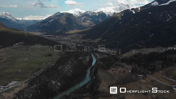 Aerial shot of river Inn with Alps in background in Tyrol, Austria