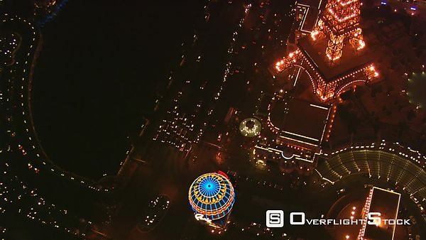 Flying above The Strip past Paris Las Vegas Eiffel Tower at night.