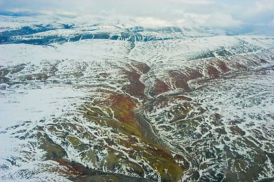 Aerial view of tundra landscape with light covering of snow, Ellesmere Island, Nunavut, Canada, June 2008. Taken on location ...