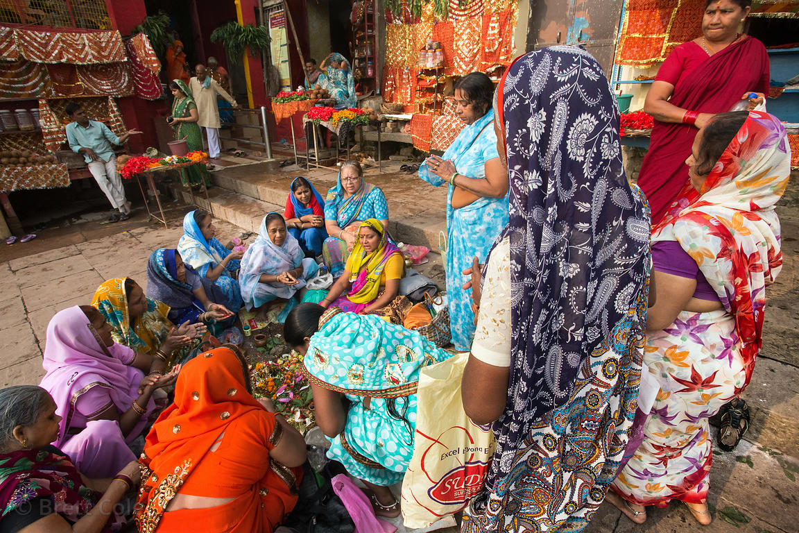 A group of ladies listen to a VIP of some sort give a talk, Dashashwamedh Ghat, Varanasi, India