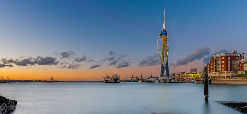 Spinnaker Tower at Sunset with Orange Sky and Milky Water