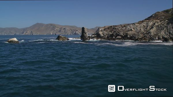 Over Shoreline Rock Formations Toward Cliffs on Catalina Coast.