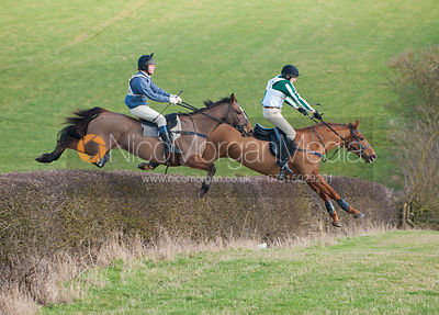 Patrick Millington and Russell Nearn jump a big hedge early on the course