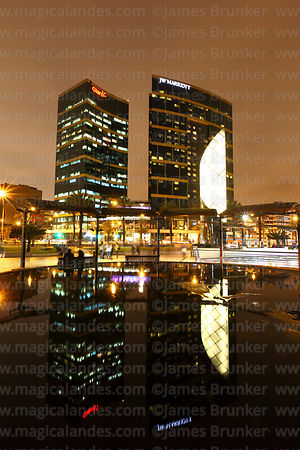 JW Marriott Hotel reflected in pool at Larcomar at sunset, Miraflores, Lima, Peru