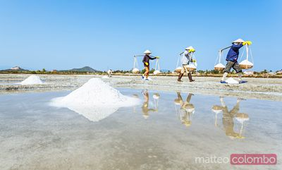Workers carrying salt, Nha Trang, Vietnam