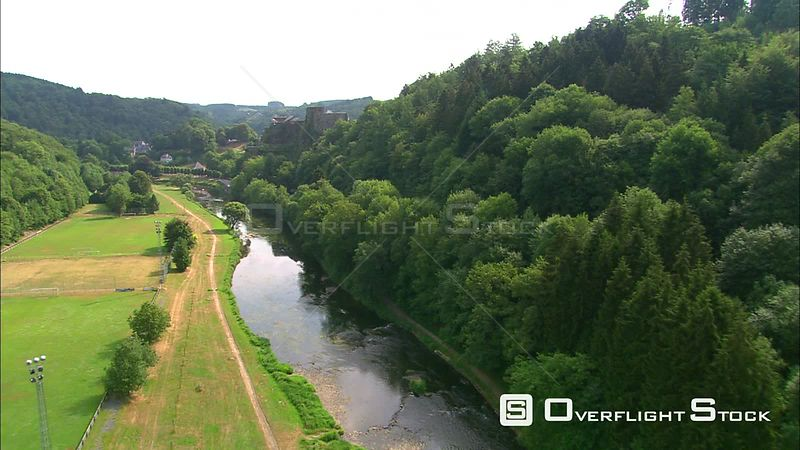 Flying along the Semois River past Castle of Bouillon, Belgium