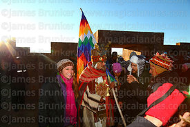 A tourist has her photo taken with a man dressed as a Tiwanaku leader during Aymara New Year celebrations, Tiwanaku, Bolivia