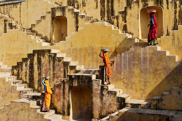 Female Laborers Collecting Water from Step Well