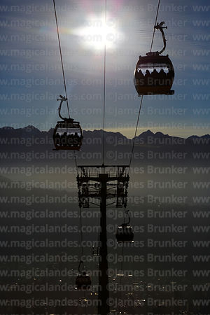 Yellow Line cable car gondolas above La Paz and minor peaks of Cordillera Real, La Paz, Bolivia