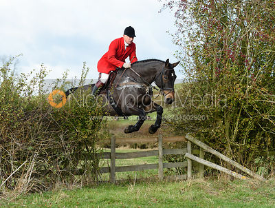 James Mossman jumping a hedge near Little Dalby. Quorn Hunt Opening Meet 2018