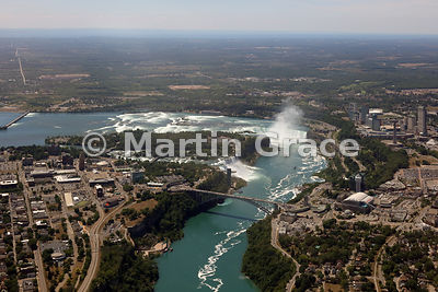 Niagara Falls from the air, looking over Niagara River to Rainbow Bridge; American and Bridal Veil Falls (USA); Goat Island (...