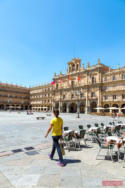 Woman walking in plaza Mayor, Salamanca, Spain