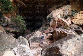 Tourist standing in entrance of Umajalanta caves, Torotoro National Park, Bolivia