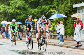 Three Cyclists Riding in the Rain
