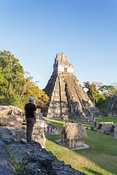 Tourist looking at the ancient mayan ruins of Tikal, Guatemala