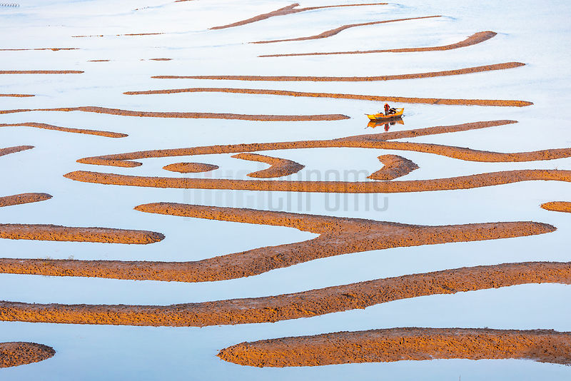 Shrimp Fisherman and Shapes in the Mud Flats at Nanwan