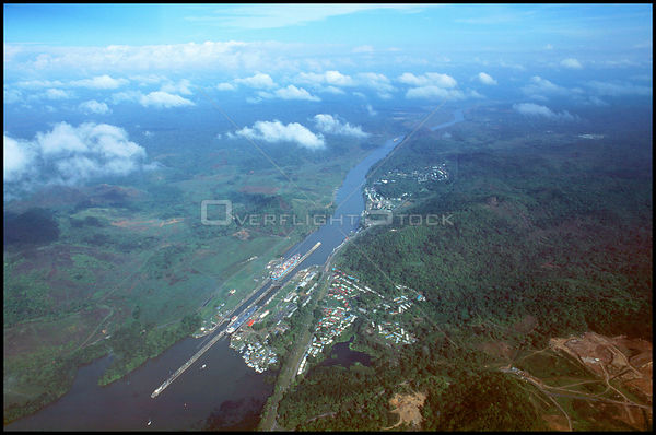 PANAMA Pedro Miguel -- Aerial photo of two ships transiting the Pedro Miguel locks and the Gaillard Cut of the Panama Canal, ...