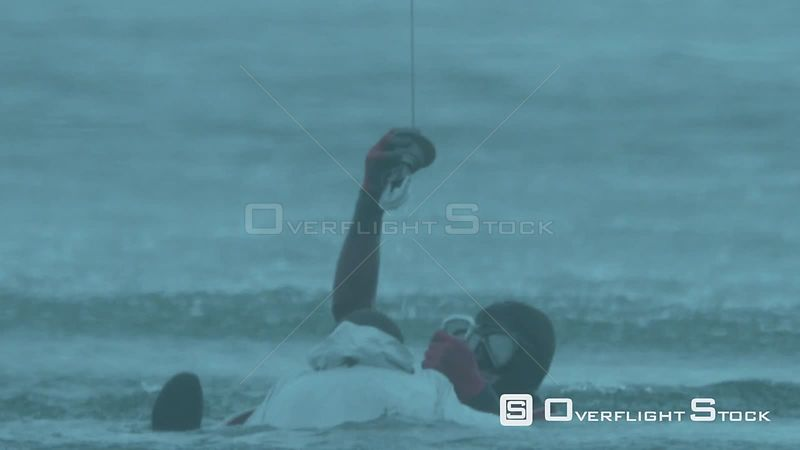 Aerial close up of a paramedic rescuing a man in the sea Cape Town Western Cape South Africa