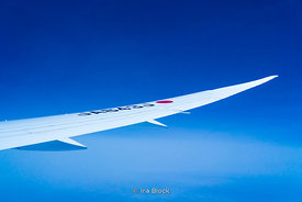 Boeing 777 wing during a flight between New York and Tokyo.