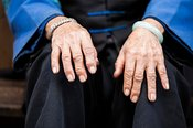 Close up of hands of old chinese woman, China