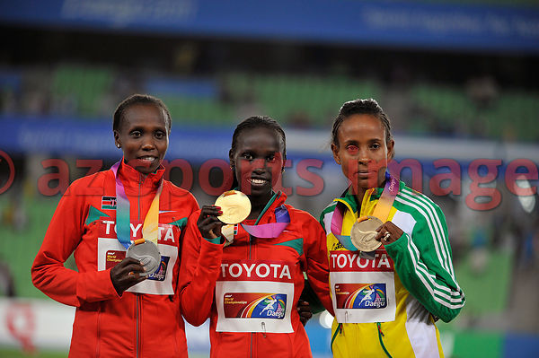 Vivian Jepkemoi Cheruiyot (centre) and S.Kibet (left) and Meseret Defar ETH (Right) hold up their medals on the winners podiu...