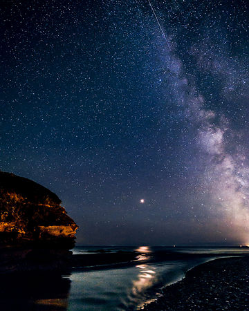 Milky Way with Mars set against Otter Head and River Otter at Budliegh Salterton, Devon, UK