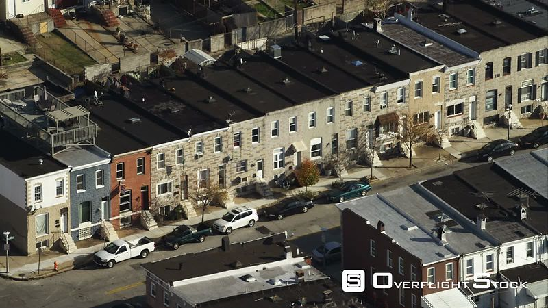 Close orbit over Baltimore row houses with zoom out to wide view. Shot in November