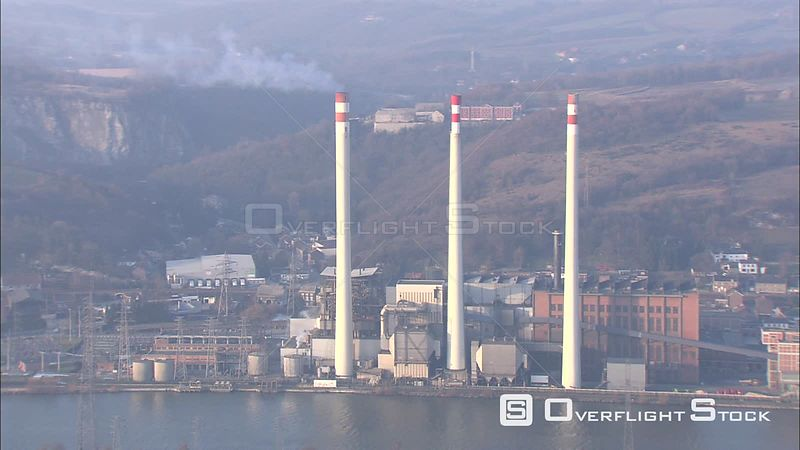 Flight past industrial smokestacks on the Meuse (Maas) River in Liege, Belgium