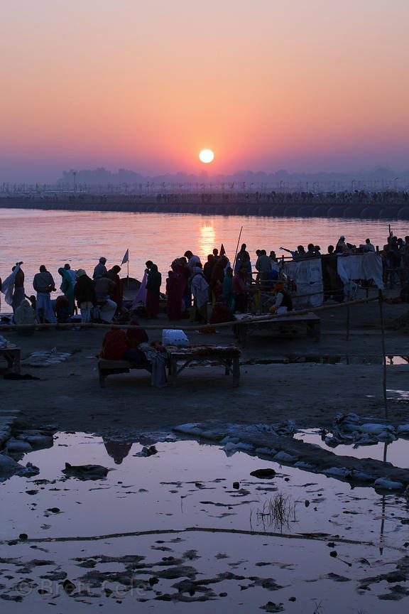 Pilgrims bathe en masse in the Ganges River at sunset, 2013 Kumbh Mela, Allahabad, India.