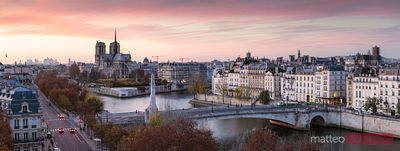 Panorama of Paris and Notre Dame cathedral at sunset