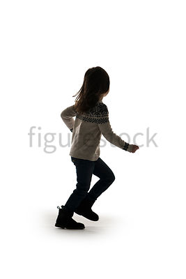 A Figurestock image of a little girl in a jumper, running, facing away – shot from eye level.