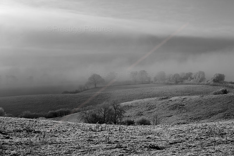Stormy, frosty morning across Cotswold Fields