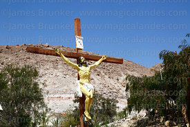 Statue of Christ on the cross next to San Martín de Tours church, Codpa, Region XV, Chile