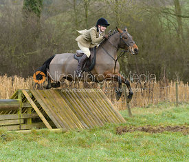 Suki Wales jumping a hunt jump at Peakes - The Fitzwilliam Hunt visit the Cottesmore at Burrough House