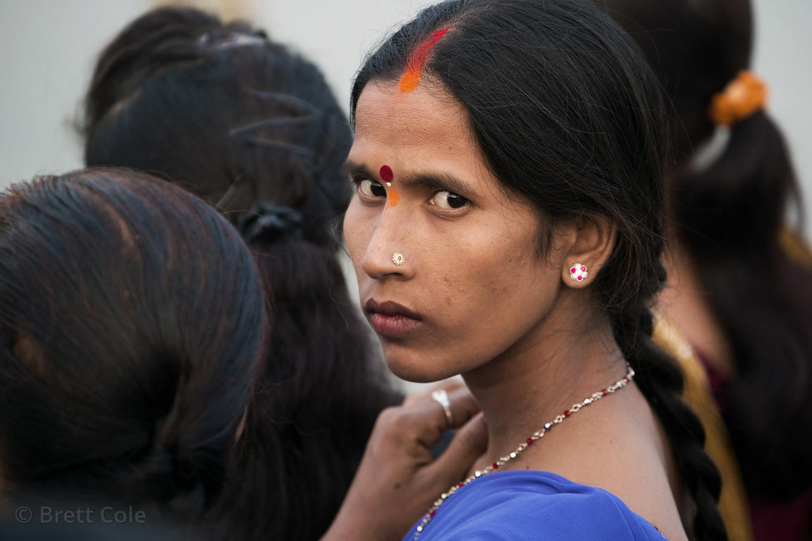 Strong look from a woman during Chhath Puja, Varanasi, India. Chhath Puja is a devotion to the Sun God Surya in which people ...