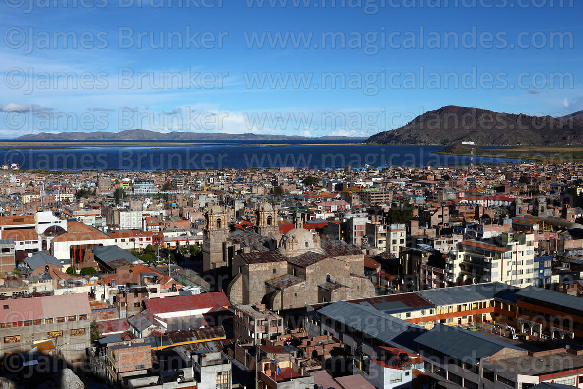 View from Cerro Huajsapata over town and cathedral to Lake Titicaca, Puno, Peru