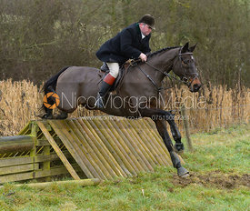George Kennedy jumping a hunt jump at Peakes - The Fitzwilliam Hunt visit the Cottesmore at Burrough House