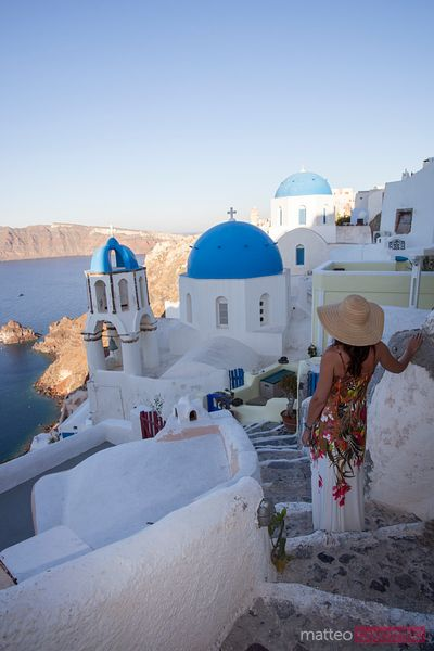 Woman looking at view in the island of Santorini
