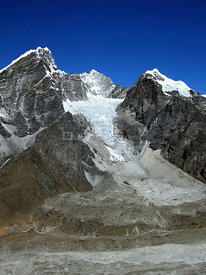 NEPAL Lobuche Glacier -- 16 Apr 2005 -- The small village of Lobuche (bottom left), dwarfed by the Lobuche Glacier (center), ...