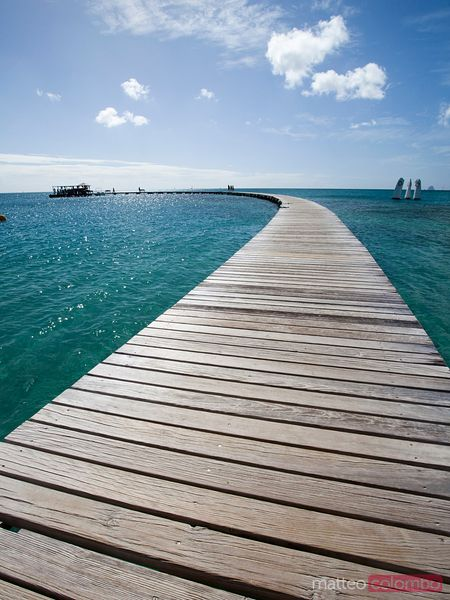 Wooden pier to caribbean sea