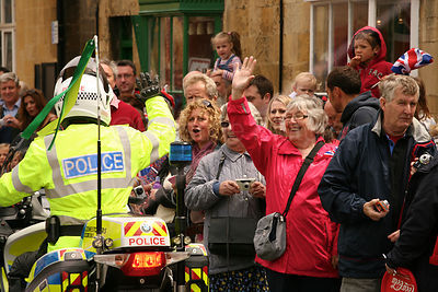 Jubilant Woman waving to Police Motorcyclist at Olympic Torch Relay