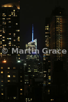 Bank of America Tower illuminated in Manhattan skyline at night, New York City, USA