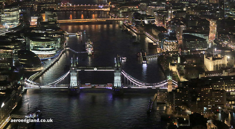 River Thames & Tower Bridge London by night. aerial photograph