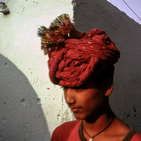 A boy walks through Kathputli Colony on his way to a performance