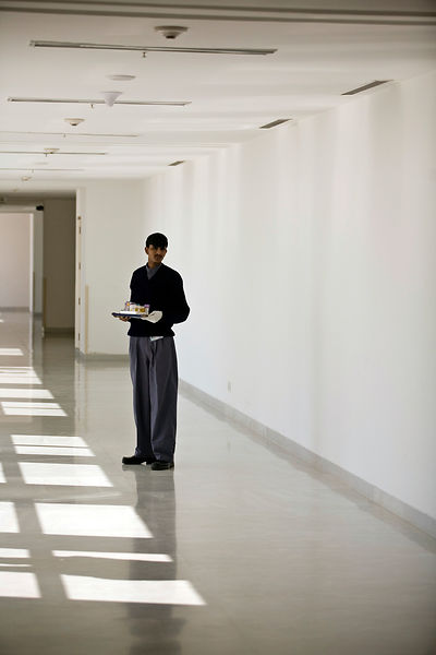 India - Delhi - An orderly waits in a corridor with samples on a tray