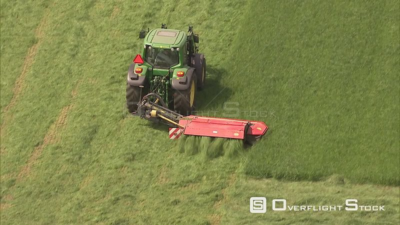 Tractor mowing a field in the Flevopolder, The Netherlands