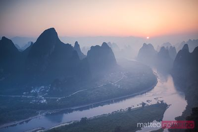 Sunrise over Li river and famous karst mountains, China