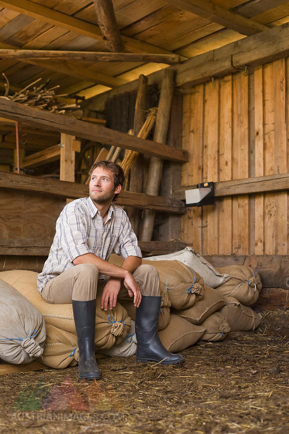 Farmer sitting in barn