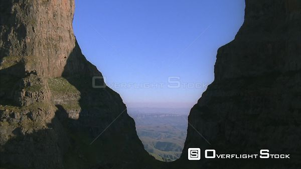 Aerial through a gap of two peaks to reveal a breathtaking mountainous landscape Sabie. Mpumalanga South Africa