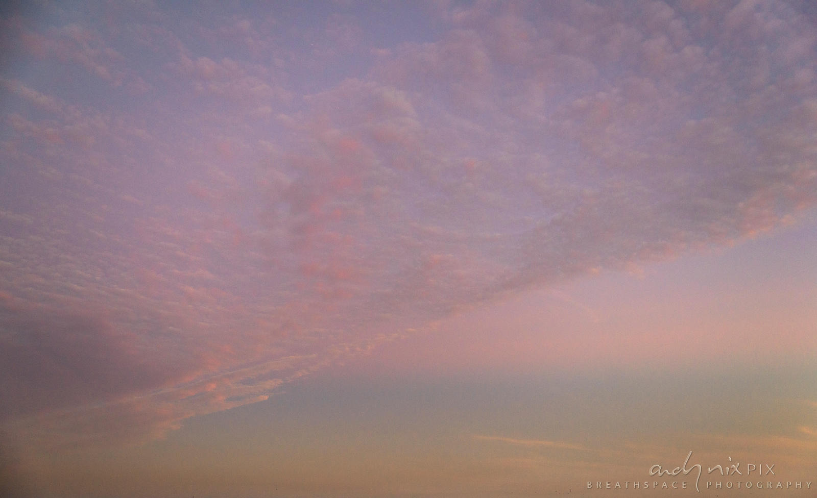 Pink clouds in a blue sky.